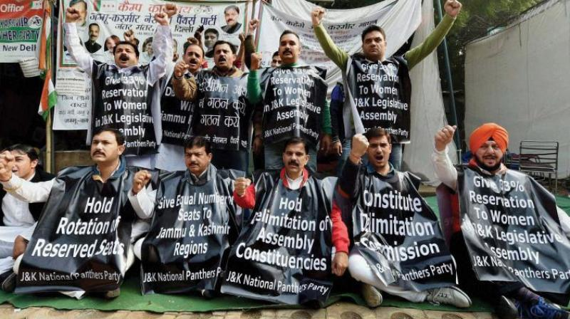 Activists of Jammu and Kashmir National Panthers Party (JKNPP) shout slogans to protest the alleged neglect of J&K by the Centre in the process of delimitation, at Jantar Mantar in New Delhi. (Photo: PTI)