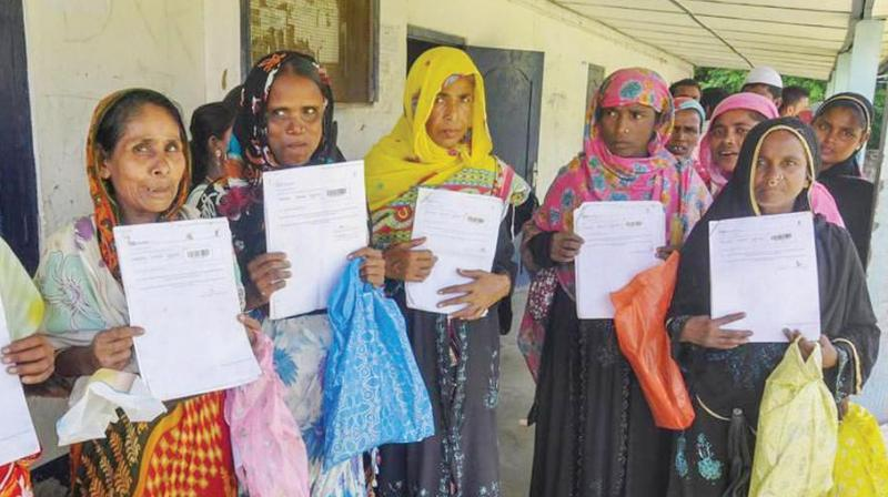 Women queue up to verify their names in the final draft of the National Register of Citizens at Morigoan. (Photo: PTI)
