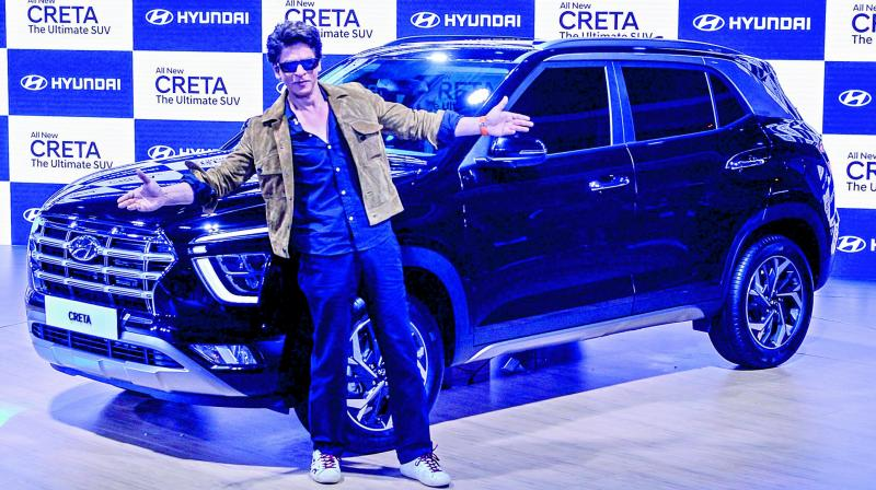 Bollywood actor Shah Rukh Khan poses infront of the all new Creta SUV