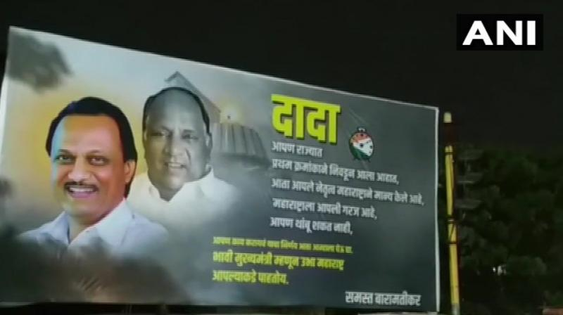 The poster has photos of Ajit Pawar and his uncle Sharad Pawar, whose party is the key constituent of newly- formed ''Maha Vikas Aghadi'' with the Shiv Sena and the Congress. (Photo: ANI)