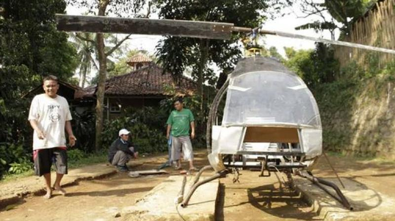 Jujun Junaedi spends his free time in a backyard tinkering with his project, guided by instructional videos, as he dreams of flying above the snarled roads of his hometown Sukabumi. (Photo: AFP)
