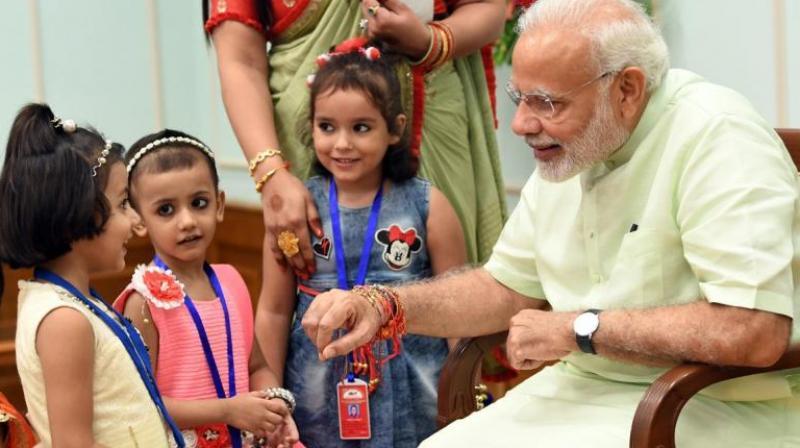 Children tie Rakhi to PM Modi, President Kovind to celebrate