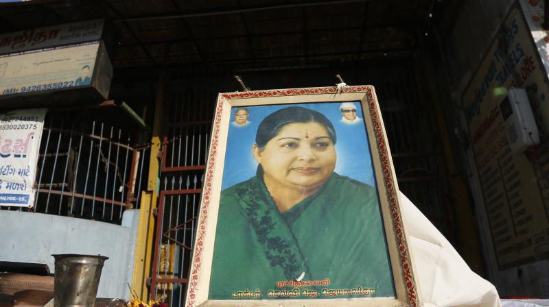 A photograph of popular politician and former film actress Jayaram Jayalalithaa is displayed outside a Hindu temple following her death in Ahmadabad. (Photo: PTI)