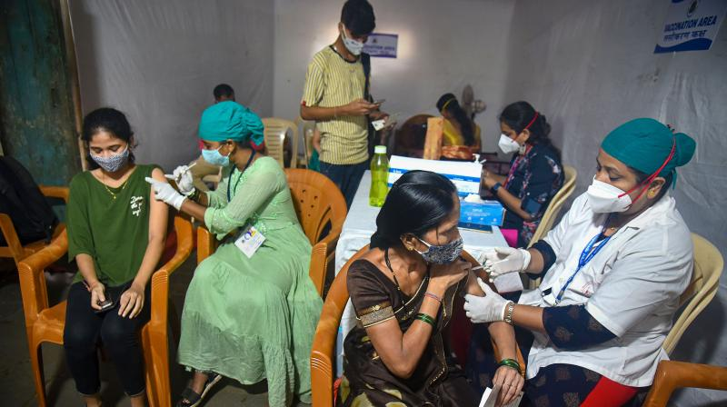 Health workers administer COVID-19 vaccine dose to beneficiaries during a vaccination drive for tribal people at Aarey Colony in Mumbai, Tuesday, August 3, 2021. (PTI)