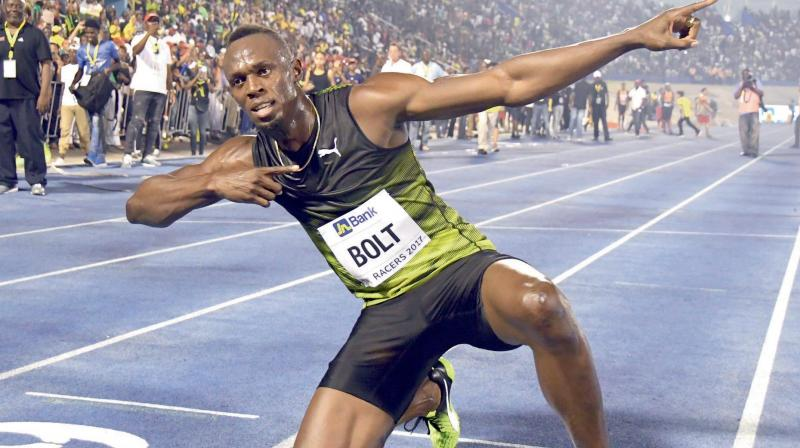 "Jamaica's Usain Bolt celebrates after winning the ""Salute to a Legend"" 100m race at the Racers Grand Prix at the National Stadium in Kingston on June 10. It was his last race on home soil as he plans to retire from track and field after the 2017 London World Championships in August. (Photo: AP)"