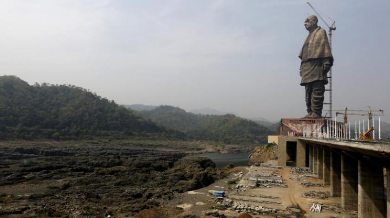 The under construction statue of unity stands facing Sardar Sarovar Dam at Kevadiya Colony, about 200 kilometers (125 miles) from Ahmedabad, India. The statue, a 182-meters tall tribute to Indian freedom fighter Sardar Vallabhbhai Patel.  (Photo: AP)