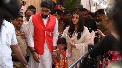 Aaradhya Bachchan with Aishwarya and Abhishek.