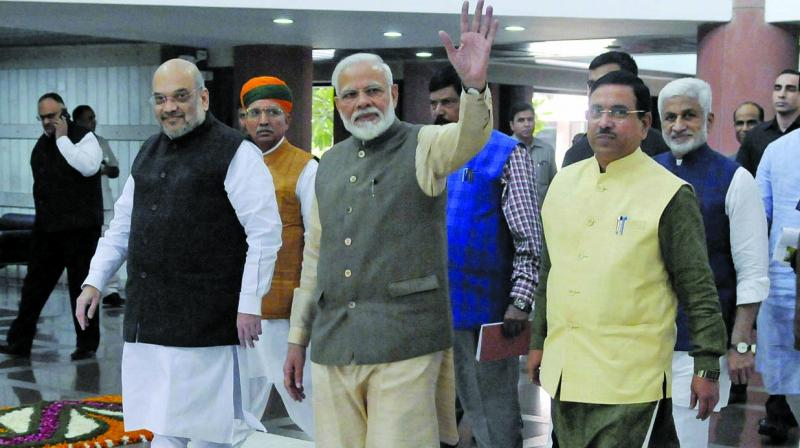 Prime Minister Narendra Modi with Union home minister Amit Shah and others at Parliament Library Building in New Delhi on Sunday after attending an all-party meeting ahead of the Winter Session. 	(Photo: Pritam Bandyopadhyay)