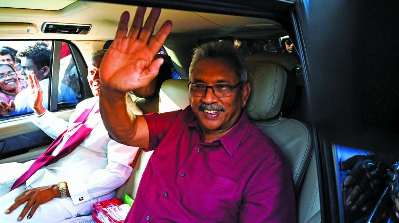 Sri Lanka's President-elect Gotabaya Rajapaksa waves at supporters as he leaves the election commission office in Colombo on Sunday. (Photo: AFP)