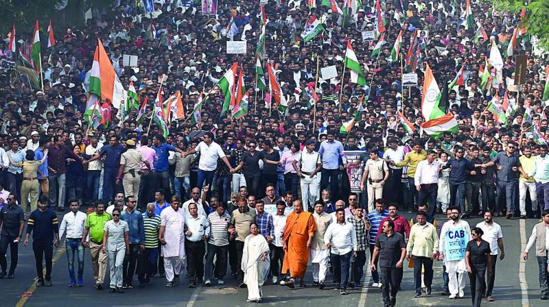 West Bengal chief minister Mamata Banerjee leads a rally in Kolkata on Monday along with thousands of supporters and vowed not to allow the proposed country-wide NRC and the amended Citizenship Act in West Bengal. (Photo: PTI)