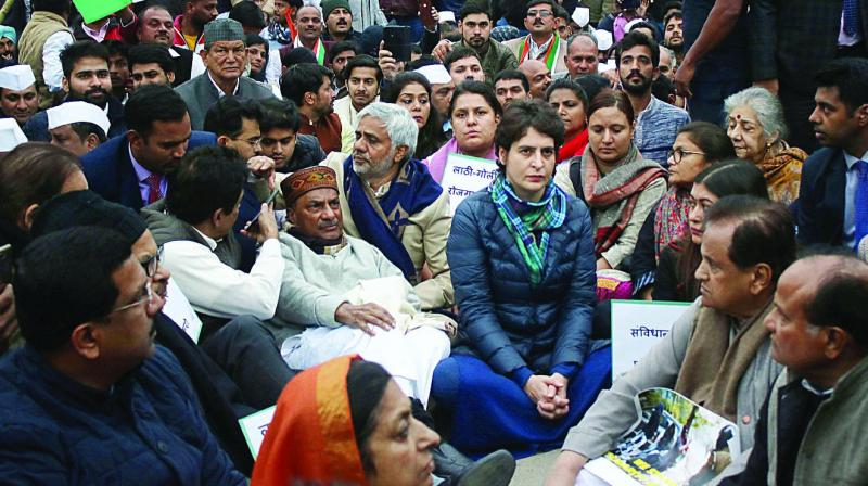 Congress leader Priyanka Gandhi Vadra with party leaders A.K. Antony, Ahmed Patel and others holds a sit-in at India Gate in New Delhi on Monday in a show of solidarity with Jamia Millia Islamia students. (Photo; Asian Age)