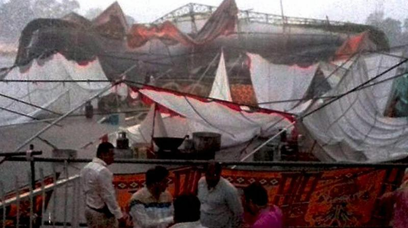 A pandal collapsed due to heavy storm in 'Pranam Indore' programme in Indore, Madhya Pradesh. (Photo: PTI)