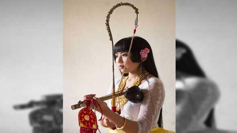 Mangka Mayanglambam, a Pena player, is striving to revive the rich folk culture and music of the state. (Photo: ANI)