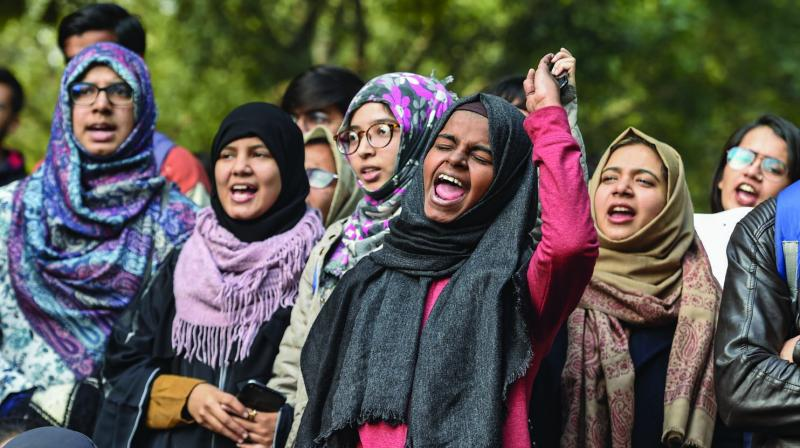 Women shout slogans during their demonstration against the CAA and NRC at Jantar Mantar in New Delhi on Tuesday. (Photo: PTI)
