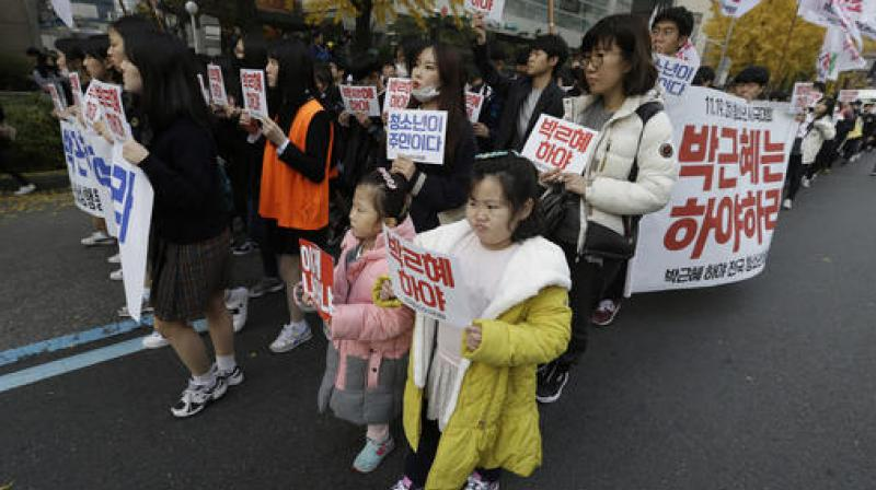 South Korean children march with high school students during a rally calling for South Korean President Park Geun-hye to step down in Seoul, South Korea.  (Photo: AP)