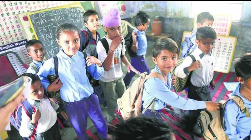 Students of a government primary school in Haryana. Under the new government intiative to improve primary education, schools will be made bag-free and instad they will be provided locker facilities so that burden on students can be reduced.