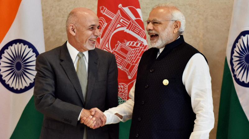 Prime Minister Narendra Modi and Afghanistan's President Ashraf Ghani during Sixth Heart of Asia Conference in Amritsar on Sunday. (Photo: PTI)