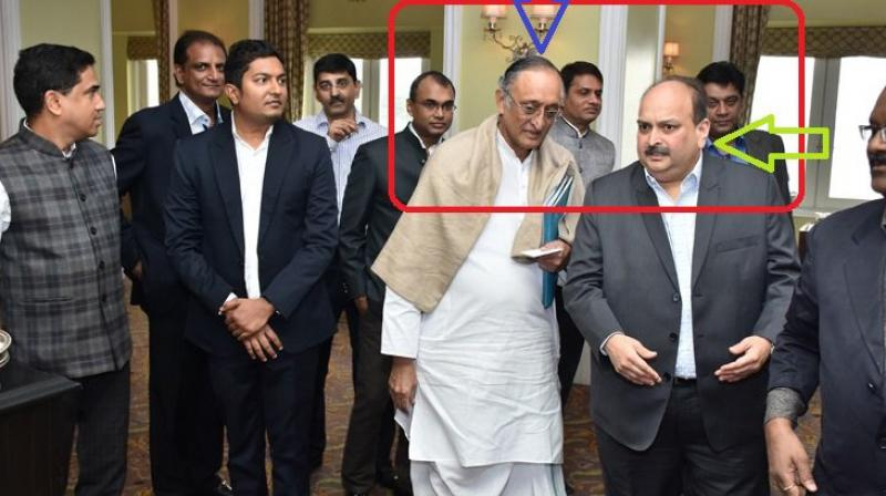State finance minister Amit Mitra with Mehul Choksi.  (Photo: Twitter account of state BJP president Dilip Ghosh)