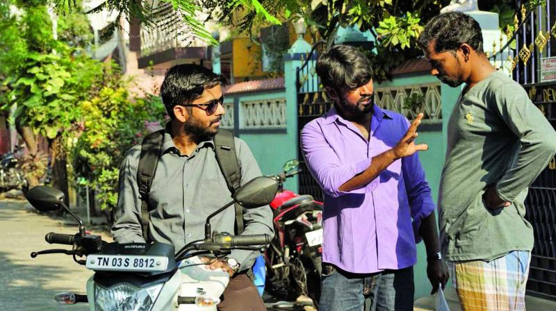 Lead Characters and Director Nandha Kumar at the center.