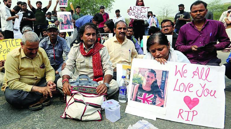Parents of a Class 9 student who had committed  suicide allegedly after failing in papers protest outside a private school in Mayur Vihar in east Delhi on Thursday, demanding a CBI probe. (Photo: GH Jha)