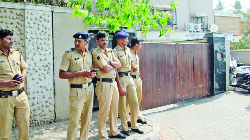 Policemen stand guard outside Salman Khan's house on Thursday. (Photo: Mrugesh Bandiwadekar)