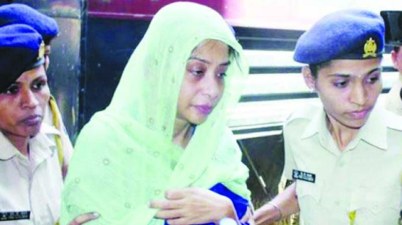 File picture of Indrani Mukerjea with the police.