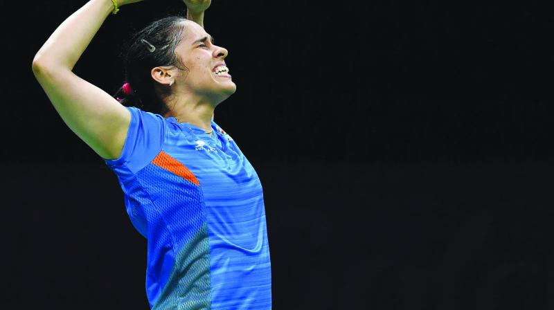 Saina Nehwal celebrates her 21-18, 23-21 win over P.V. Sindhu in their women's single final at the Commonwealth Games in Gold Coast on Sunday. (Photo: AFP)