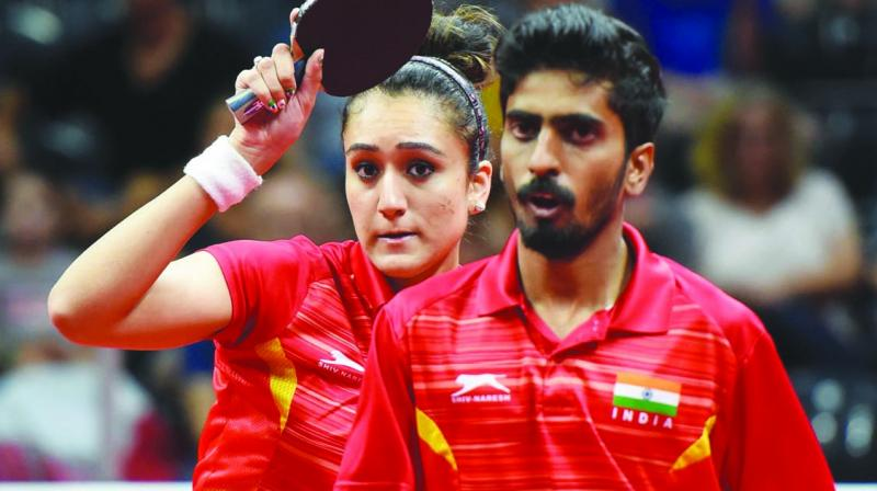 Manika Batra and G. Sathi-yan en route to their mixed doubles bronze medal. (Photo: AFP)