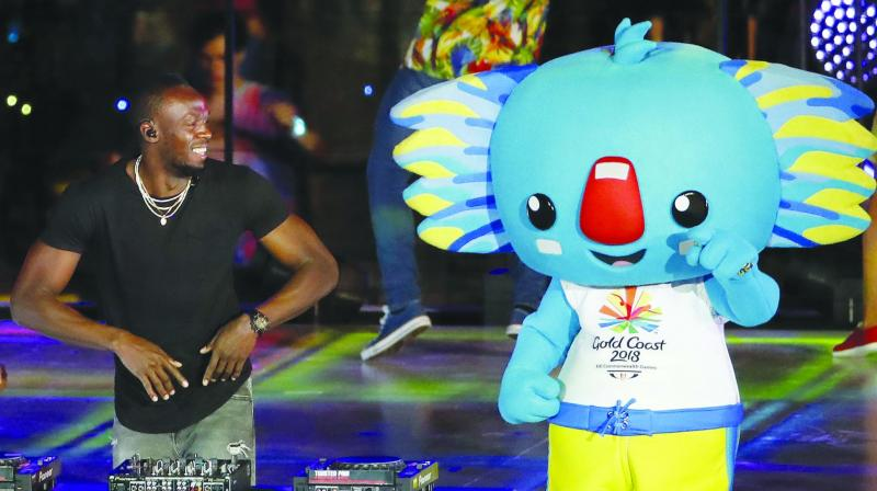 Retired Jamaican sprinter Usain Bolt performs as a DJ at the closing ceremony. (Photo: AP)