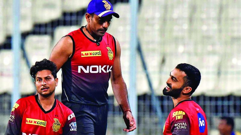 KKR's Kuldeep Yadav (from left), Robin Uthappa and Dinesh Karthik.