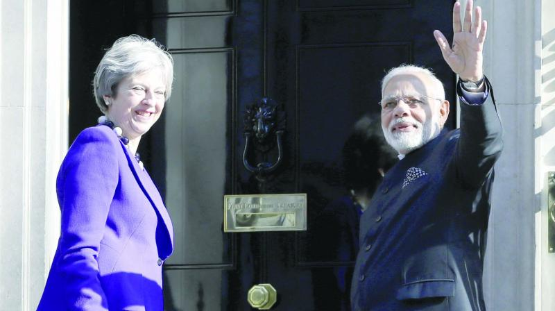 Britain's Prime Minister Theresa May welcomes Prime Minister Narendra Modi at 10, Downing Street in London. (Photo: AP)