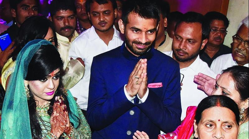 RJD chief Lalu Prasad Yadav's son Tej Pratap Yadav with fiancee Aishwarya Rai during their engagement in Patna on Wednesday. Former Bihar CM Rabri Devi and his mother is also seen. (Photo: PTI)