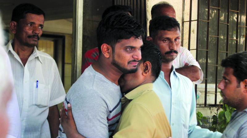 The deceased's son, Omkar Sawant, at the funeral.