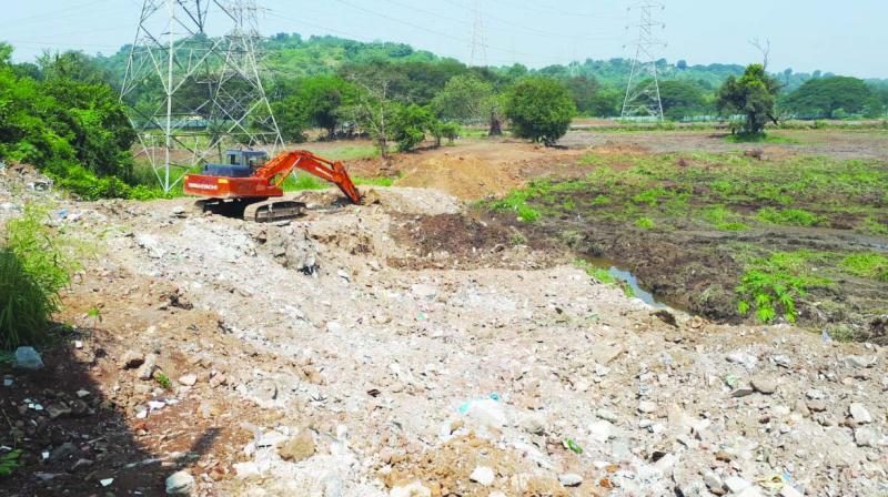 Debris dumped near metro construction site in Aarey.