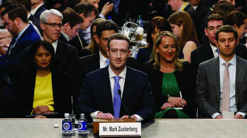 In this file photo, Facebook CEO Mark Zuckerberg arrives to testify before a House Energy and Commerce hearing on Capitol Hill in Washington, about the use of Facebook data to target American voters in the 2016 election and data privacy. (Photo: AP)