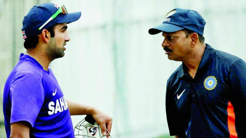 India A team coach Lalchand Rajput with skipper Gautam Gambhir during a practice  session ahead of the 2nd practice match against Australia, in Chennai in 2014.