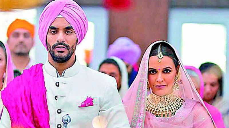 Angad Bedi and Neha Dhupia.