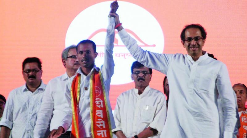 Shrinivas Vanaga and Shiv Sena chief Uddhav Thackeray.