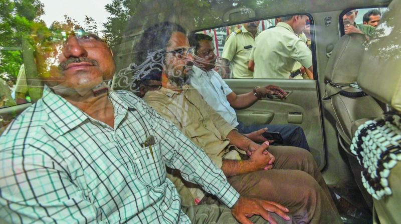 One of the accused arrested by Pune police over 'Maoist links' in the Bhima-Koregaon violence case, is taken to court in Pune on Thursday.  (Photo: PTI)
