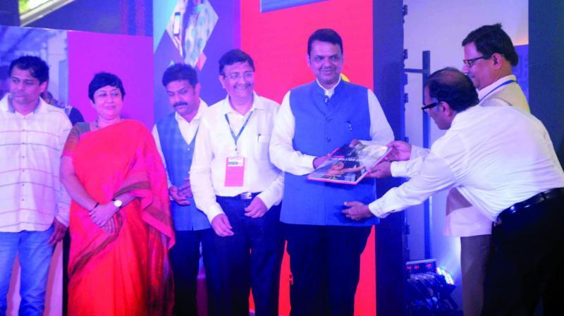 CM Devendra Fadnavis launches mobile ticketing service at Versova station on Friday. (Photo: Mrugesh Bandiwadekar)