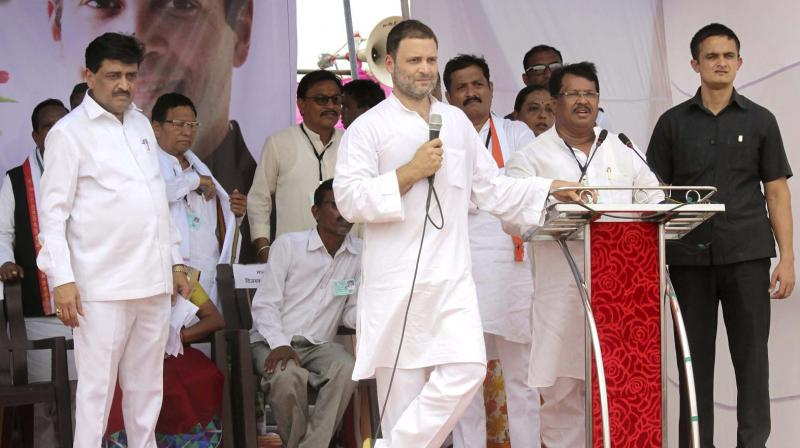 Congress Party President Rahul Gandhi speaks during 'Chaupal pe Charcha' an interaction session with farmers at Nanded village in Chandrapur district of Maharashtra. (Photo: PTI)