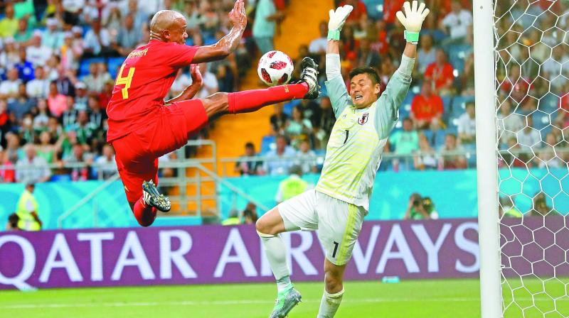 Belgium's Vincent Kompany (left) in action against Japan goalkeeper Eiji Kawashima in their Round of 16 match at the Rostov Arena in Rostov-on-Don on Monday.	(Photo: AP)
