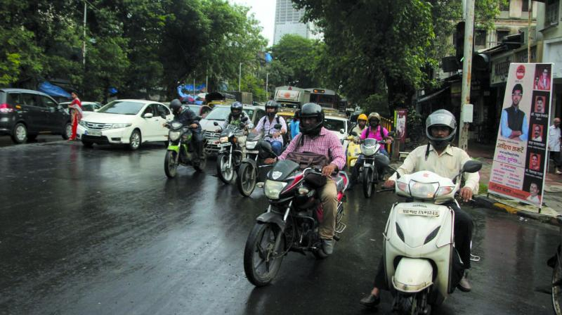 The percentage of motorists who use helmets rose from 63 in 2015 to 92 this year. (Photo: Mrugesh Bandiwadekar)