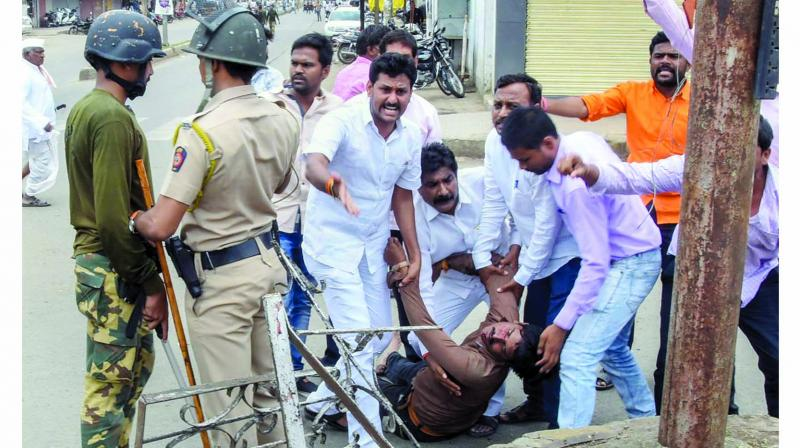 A protester is carried away after being injured during a protest rally in Nanded. (Photo: PTI)