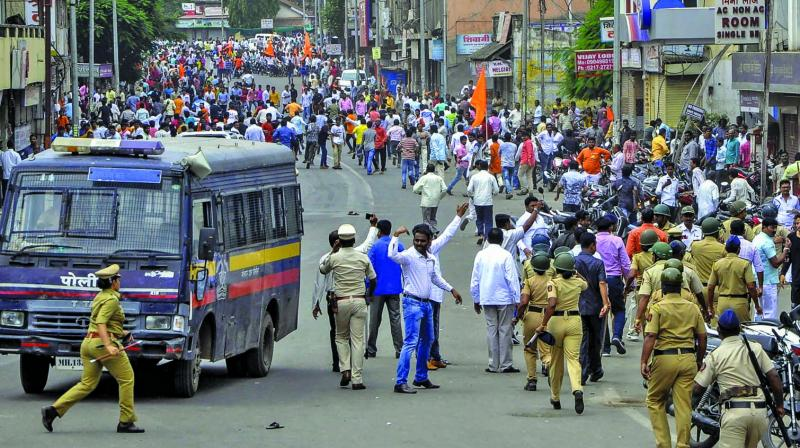 Police clash with the Maratha Kranti Morcha protesters during their district bandh called for reservations in jobs and education, in Solapur, on Monday. (Photo: PTI)