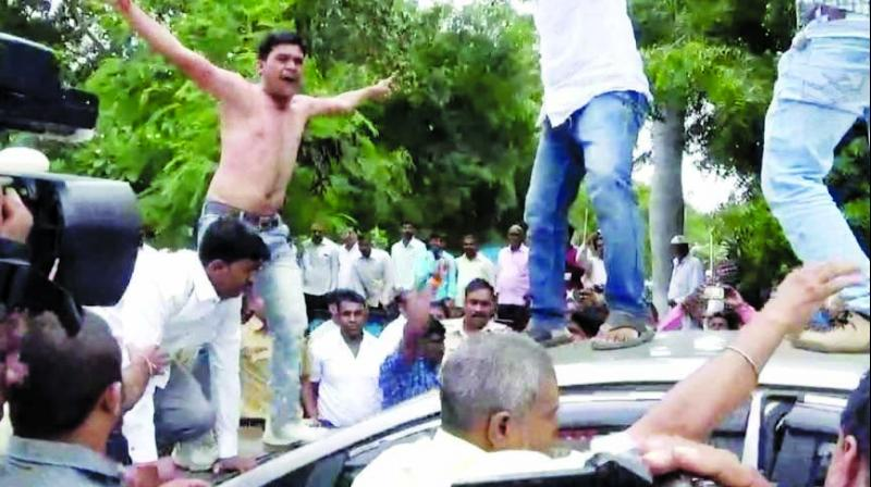 Protesters climbed on top of Dhule MP Hina Gavit's car while she was heading to district collector's office.