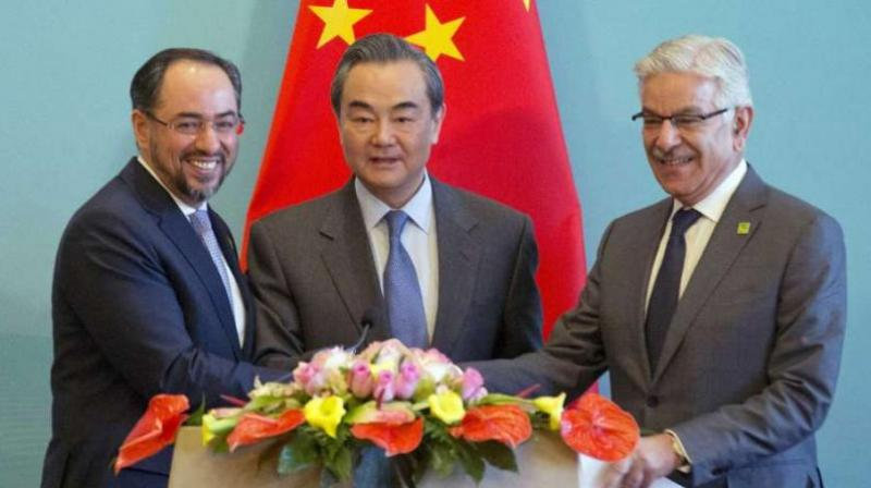 (From left) Afghanistan foreign minister Salahuddin Rabbani, Chinese foreign minister Wang Yi and Pakistani foreign minister Khawaja Asif at press conference for the 1st China-Afghanistan-Pakistan Foreign Ministers' Dialogue in Beijing on December 26, 2017. (Photo: AP)