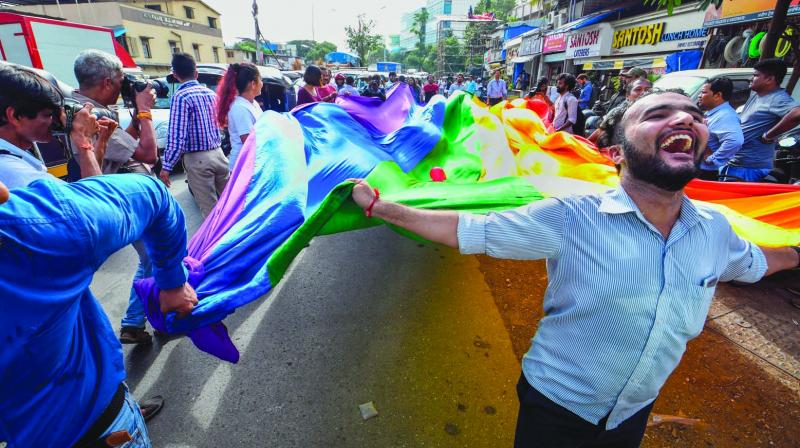 LGBTQ community members celebrate after the Supreme Court verdict which decriminalises consensual gay sex, in Mumbai. (Photo: PTI)