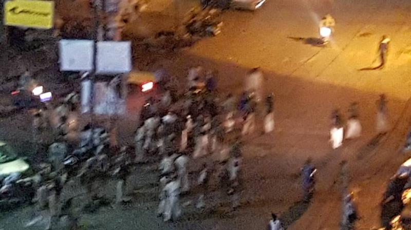 People gather around the hospital premises where the clash broke out, in Bhopal. (Photo: Twitter | @followersfreee6)