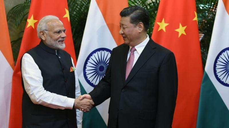 Chinese President Xi Jinping with Indian Prime Minister Narendra Modi (AFP)